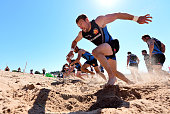 Matt Jess of Exeter Chiefs sprints up a sand dune during a training session on Exmouth Beach on July 19 2016 in Exmouth England