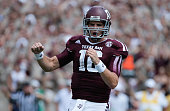 Matt Joeckel of the Texas AM Aggies celebrates a second quarter touchdown during the game against the Rice Owls at Kyle Field on August 31 2013 in...