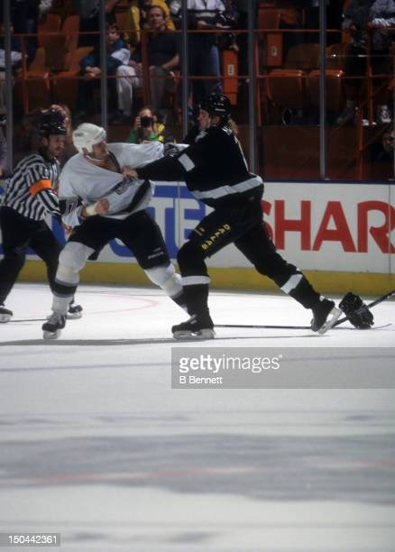 Matt Johnson of the Los Angeles Kings fights with Derian Hatcher of the Dallas Stars on November 15 1997 at the Great Western Forum in Inglewood...