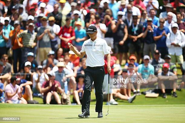 Matt Jones of Australia acknowledges the crowd after putting on the 4th hole during day four of the Australian Open at The Australian Golf Club on...