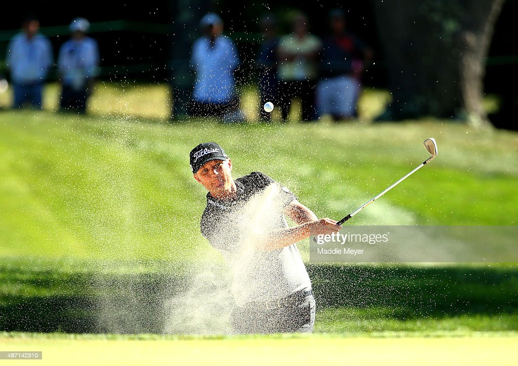 Matt Jones of Australia hits out of the bunker on the seventh hole during round three of the Deutsche Bank Championship at TPC Boston on September 6...
