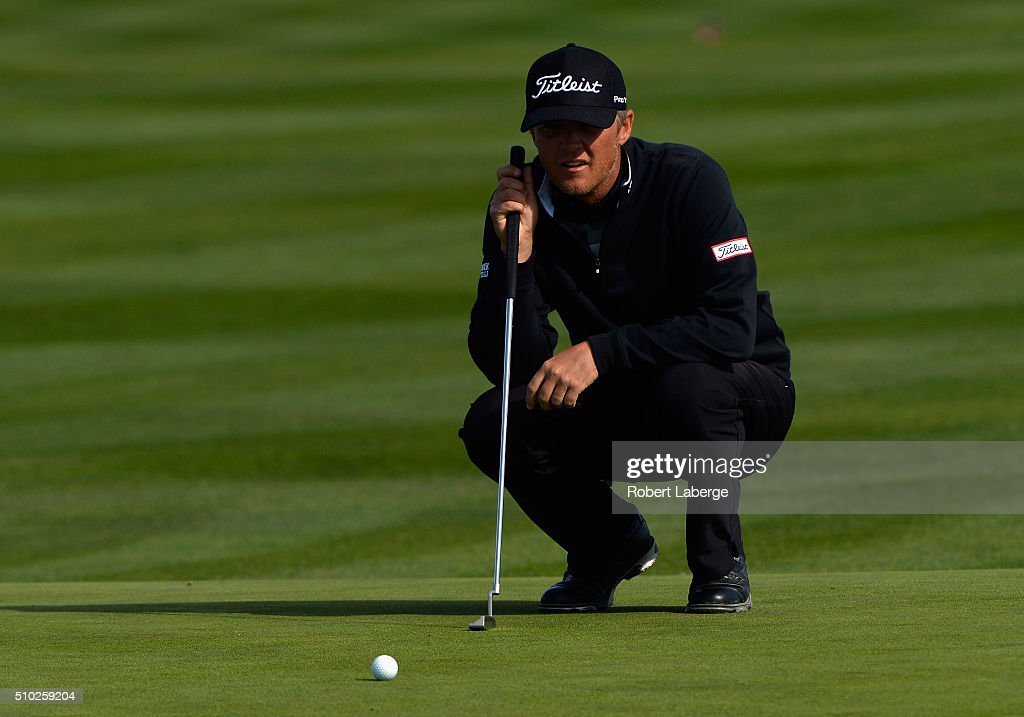Matt Jones of Australia lines up a putt on the sixth green during the final round of the AT&T Pebble Beach National Pro-Am at the Pebble Beach Golf Links on February 14, 2016 in Pebble Beach, California.
