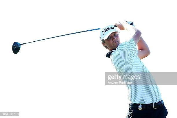 Matt Jones of Australia watches his tee shot on the ninth hole during the continuation of the weatherdelayed second round of the 2015 PGA...