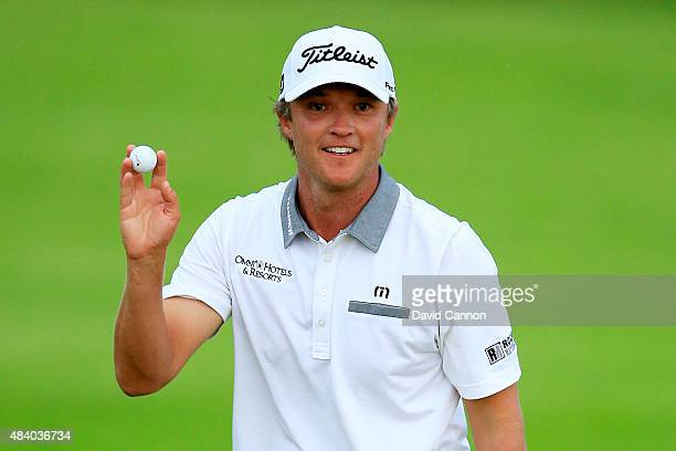 Matt Jones of Australia waves after a birdie on the 2nd hole during the second round of the 2015 PGA Championship at Whistling Straits on August 14...