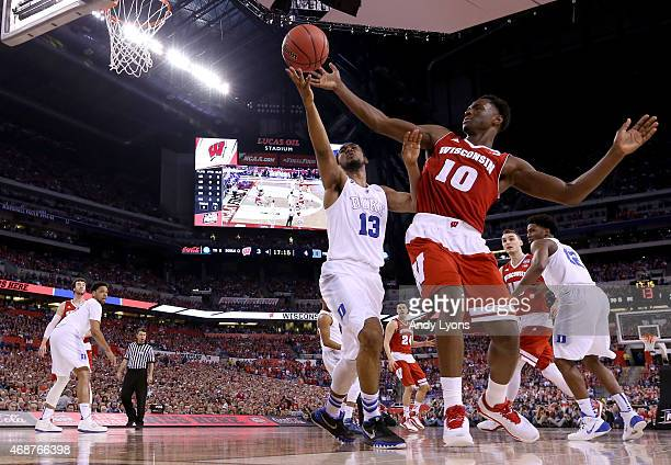 Matt Jones of the Duke Blue Devils handles the ball against Nigel Hayes of the Wisconsin Badgers in the first half during the NCAA Men's Final Four...
