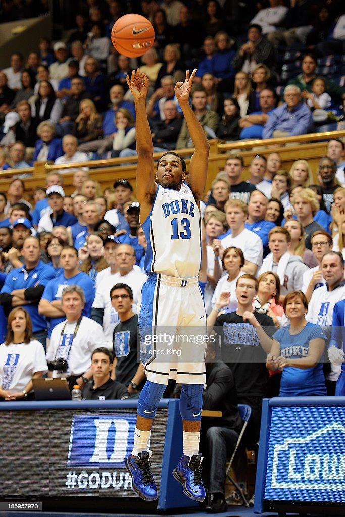<a gi-track='captionPersonalityLinkClicked' href=/galleries/search?phrase=Matt+Jones+-+Basketball+Player&family=editorial&specificpeople=14206153 ng-click='$event.stopPropagation()'>Matt Jones</a> #13 of the Duke Blue Devils puts up a shot against the Bowie State Bulldogs at Cameron Indoor Stadium on October 26, 2013 in Durham, North Carolina.
