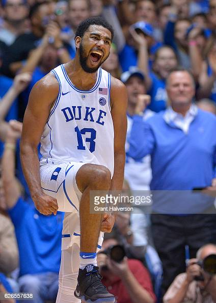 Matt Jones of the Duke Blue Devils reacts after making a threepoint basket against the Michigan State Spartans during the game at Cameron Indoor...