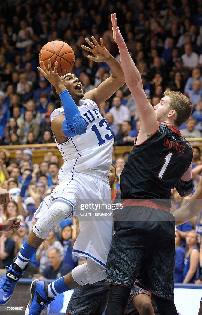 <a gi-track='captionPersonalityLinkClicked' href=/galleries/search?phrase=Matt+Jones+-+Basketball+Player&family=editorial&specificpeople=14206153 ng-click='$event.stopPropagation()'>Matt Jones</a> #13 of the Duke Blue Devils shoots against Evan Smotrycz #1 of the Maryland Terrapins during their game at Cameron Indoor Stadium on February 15, 2014 in Durham, North Carolina.