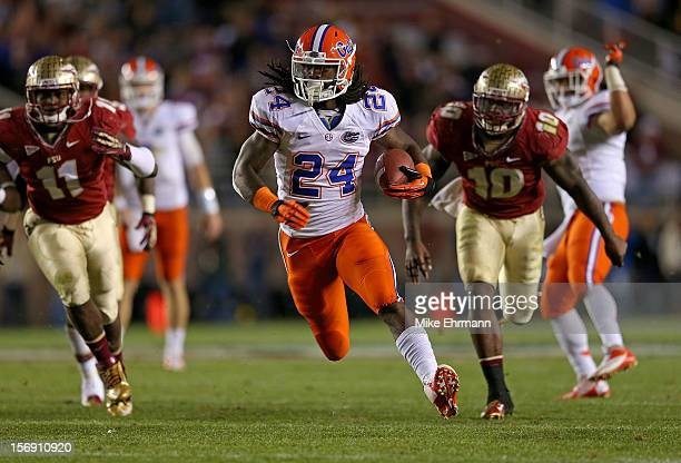Matt Jones of the Florida Gators rushes for a touchdown during a game against the Florida State Seminoles at Doak Campbell Stadium on November 24...