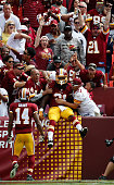 Matt Jones of the Washington Redskins celebrates after scoring a first half touchdown against the St Louis Rams at FedExField on September 20 2015 in...