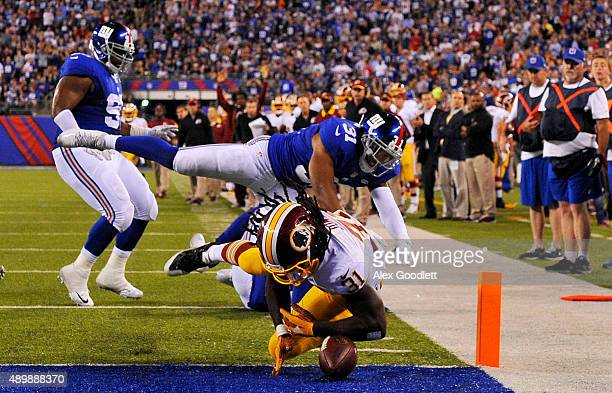 Matt Jones of the Washington Redskins drops the ball in the endzone as Trevin Wade of the New York Giants defends in the fourth quarter at MetLife...