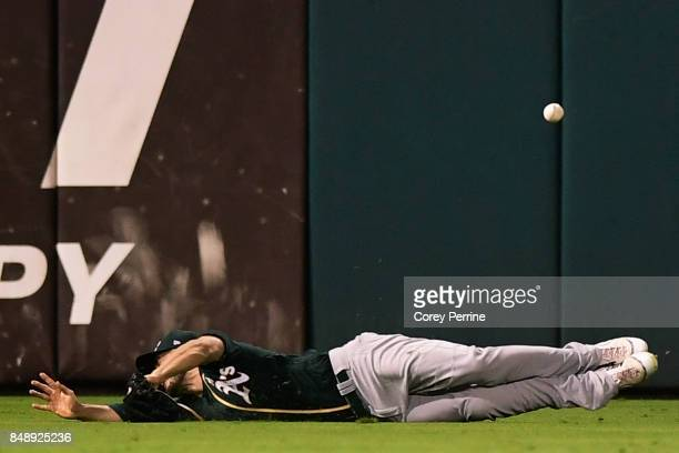 Matt Joyce of the Oakland Athletics can't reach a double hit by Ty Kelly of the Philadelphia Phillies at Citizens Bank Park on September 16 2017 in...