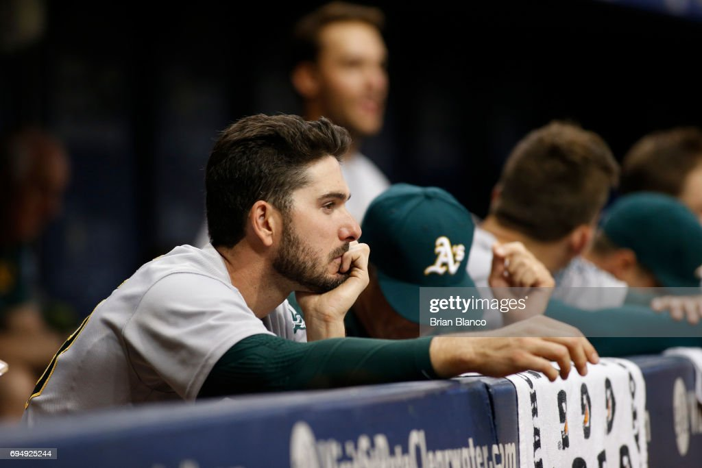 Matt Joyce #23 of the Oakland Athletics looks on from the dugout during the ninth inning of a game against the Tampa Bay Rays on June 11, 2017 at Tropicana Field in St. Petersburg, Florida.