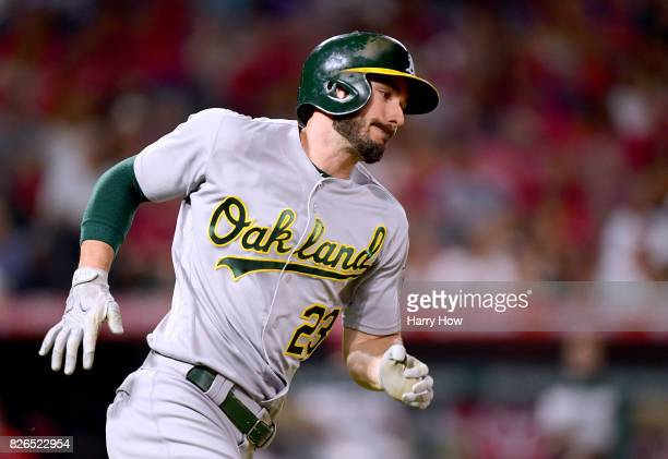 Matt Joyce of the Oakland Athletics runs on his RBI double to take a 62 lead over the Los Angeles Angels during the sixth inning at Angel Stadium of...