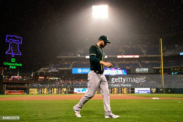 Matt Joyce of the Oakland Athletics walks off the field against the Philadelphia Phillies during the third inning after a 90 minute rain delay was...