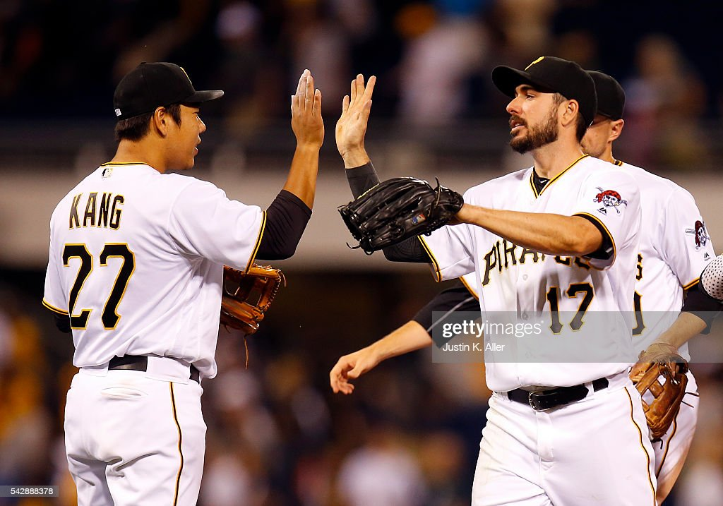 <a gi-track='captionPersonalityLinkClicked' href=/galleries/search?phrase=Matt+Joyce+-+Baseball+Player&family=editorial&specificpeople=8640026 ng-click='$event.stopPropagation()'>Matt Joyce</a> #17 of the Pittsburgh Pirates celebrates with <a gi-track='captionPersonalityLinkClicked' href=/galleries/search?phrase=Jung+Ho+Kang&family=editorial&specificpeople=13989928 ng-click='$event.stopPropagation()'>Jung Ho Kang</a> #27 of the Pittsburgh Pirates after defeating the Los Angeles Dodgers 8-6 at PNC Park on June 24, 2016 in Pittsburgh, Pennsylvania.