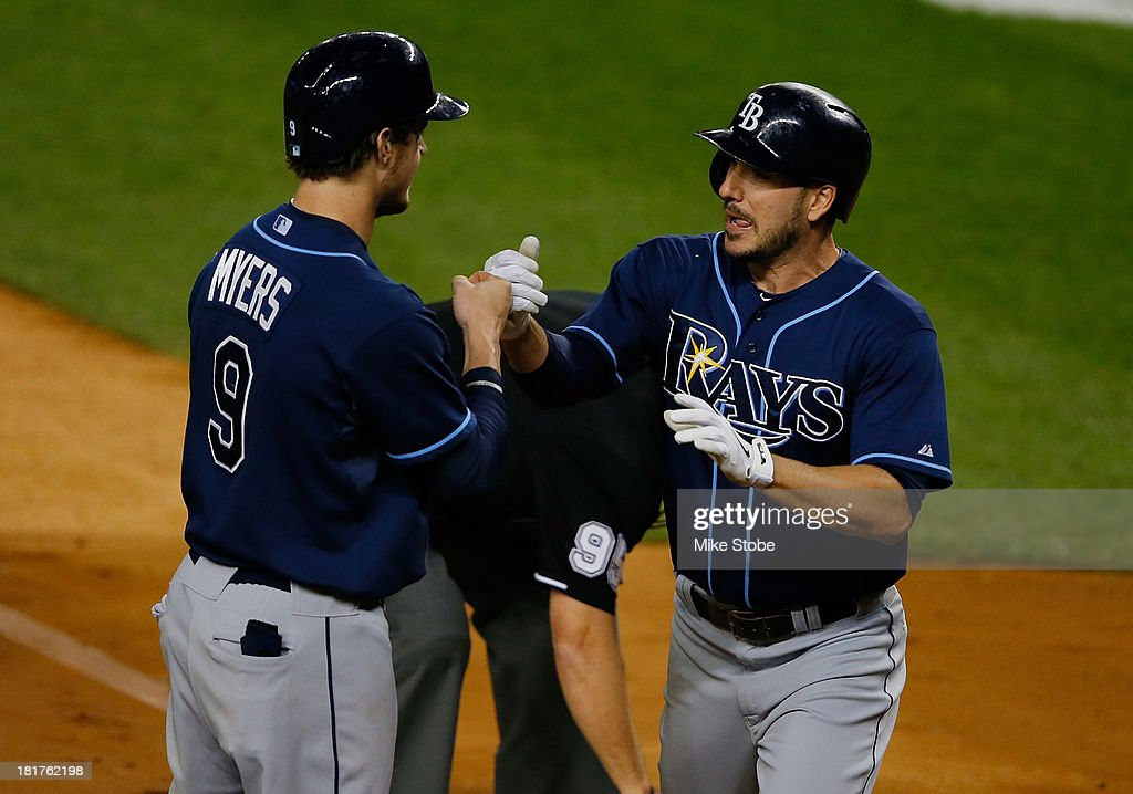 Matt Joyce #20 of the Tampa Bay Rays celebrates with <a gi-track='captionPersonalityLinkClicked' href=/galleries/search?phrase=Wil+Myers&family=editorial&specificpeople=7562808 ng-click='$event.stopPropagation()'>Wil Myers</a> #9 after hitting a lead-off home run in the first inning against the New York Yankees at Yankee Stadium on September 24, 2013 in the Bronx borough of New York City. The Rays defeated the Yankees 7-0.