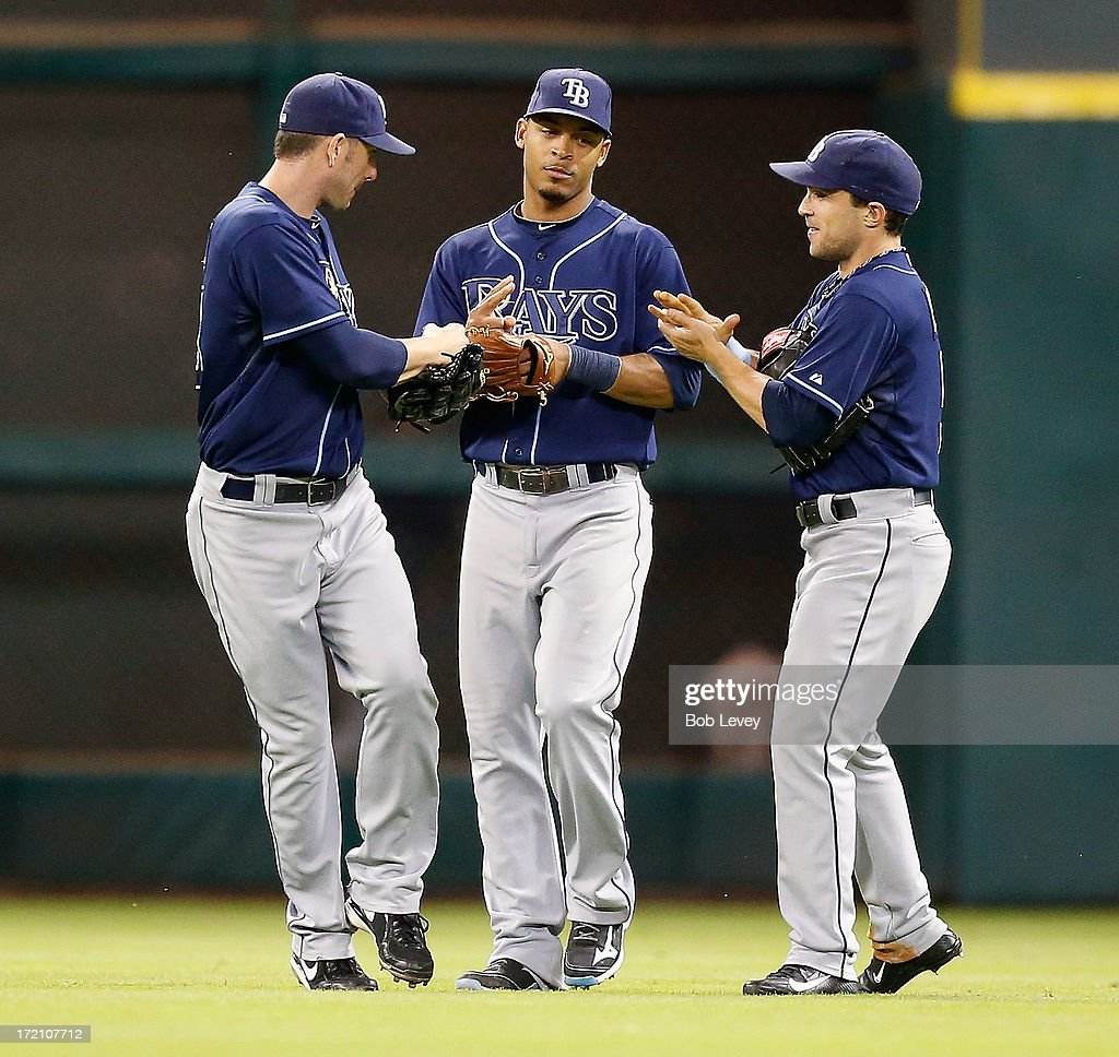 Matt Joyce #20 of the Tampa Bay Rays, Desmond Jennings #8 of the Tampa Bay Rays and Sam Fuld #5 of the Tampa Bay Rays celebrate their 12-0 win over the Houston Astros at Minute Maid Park on July 1, 2013 in Houston, Texas.