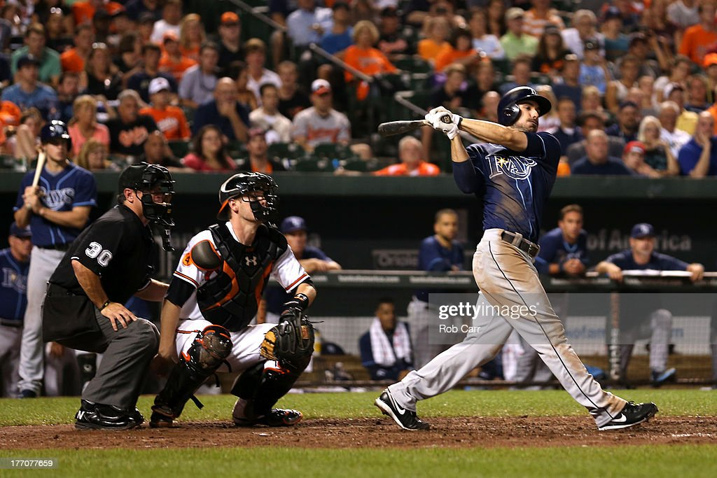 Matt Joyce #20 of the Tampa Bay Rays follows his two RBI double as home plate umpire <a gi-track='captionPersonalityLinkClicked' href=/galleries/search?phrase=Rob+Drake&family=editorial&specificpeople=247242 ng-click='$event.stopPropagation()'>Rob Drake</a> and catcher <a gi-track='captionPersonalityLinkClicked' href=/galleries/search?phrase=Matt+Wieters&family=editorial&specificpeople=4498276 ng-click='$event.stopPropagation()'>Matt Wieters</a> #32 of the Baltimore Orioles look on during the ninth inning of the Rays 7-4 win at Oriole Park at Camden Yards on August 20, 2013 in Baltimore, Maryland.
