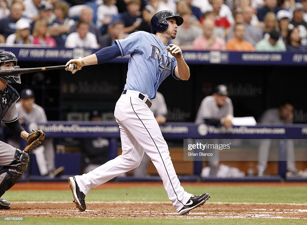 Matt Joyce #20 of the Tampa Bay Rays hits a sacrifice fly to score teammate James Loney during the seventh inning of a game against the New York Yankees on April 20, 2014 at Tropicana Field in St. Petersburg, Florida.