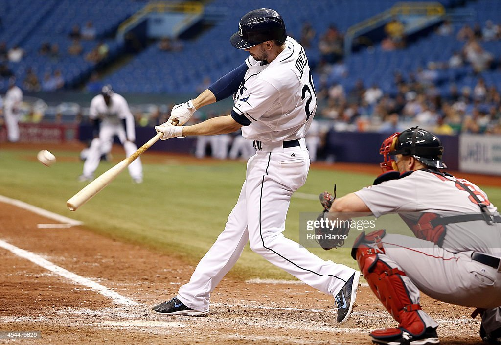 Matt Joyce #20 of the Tampa Bay Rays hits an RBI single in front of catcher Christian Vazquez #55 of the Boston Red Sox to score Sean Rodriguez to end the 10th inning of a game on September 1, 2014 at Tropicana Field in St. Petersburg, Florida.