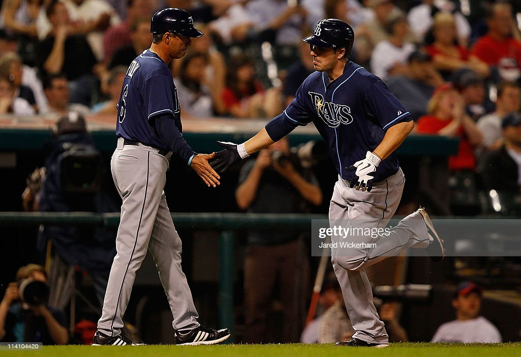Matt Joyce #20 of the Tampa Bay Rays is congratulated by third base coach Tom Foley #6 after hitting a solo home run against the Cleveland Indians during the game on May 11, 2011 at Progressive Field in Cleveland, Ohio.