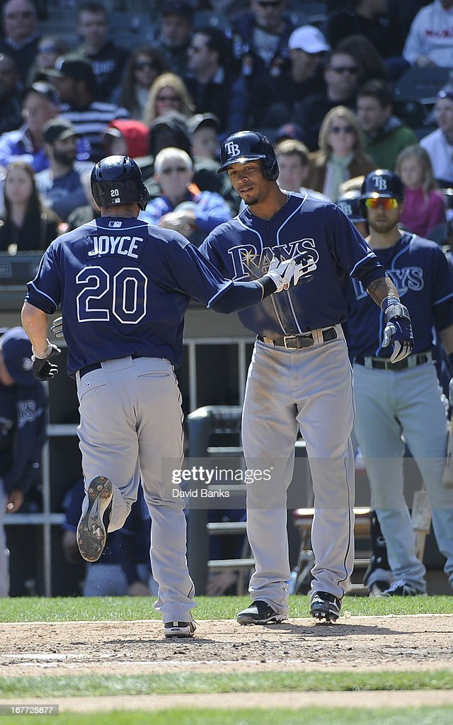 Matt Joyce #20 of the Tampa Bay Rays is greeted by <a gi-track='captionPersonalityLinkClicked' href=/galleries/search?phrase=Desmond+Jennings&family=editorial&specificpeople=5974085 ng-click='$event.stopPropagation()'>Desmond Jennings</a> #8 after hitting a two run homer against the Chicago White Sox during the sixth inning on April 28, 2013 at U.S. Cellular Field in Chicago, Illinois.