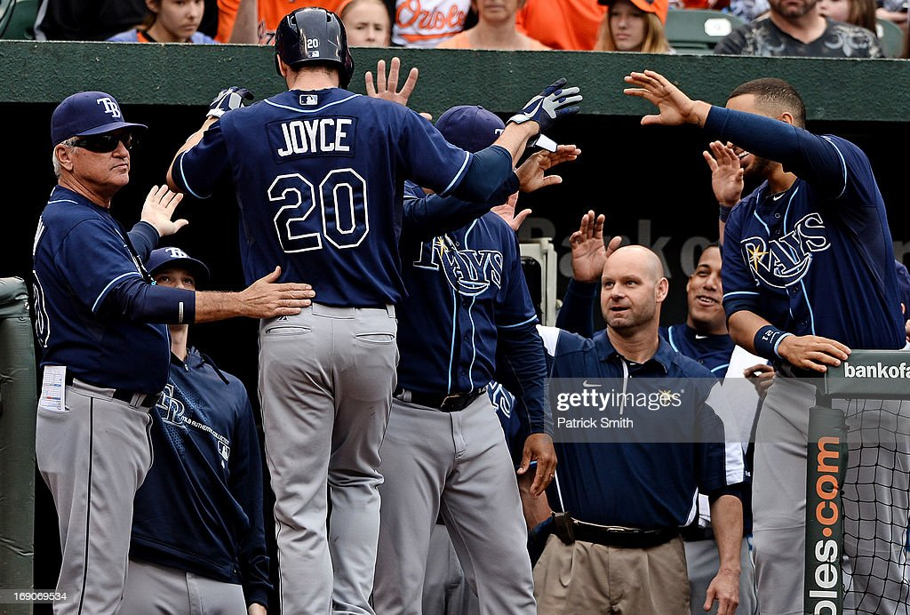 Matt Joyce #20 of the Tampa Bay Rays is greeted in the dugout after his hit was ruled a homerun after the play was reviewed against the sixth inning at Oriole Park at Camden Yards on May 19, 2013 in Baltimore, Maryland. The Tampa Bay Rays won, 3-1.