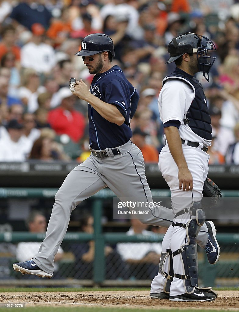 Matt Joyce #20 of the Tampa Bay Rays scores past catcher <a gi-track='captionPersonalityLinkClicked' href=/galleries/search?phrase=Alex+Avila&family=editorial&specificpeople=5749211 ng-click='$event.stopPropagation()'>Alex Avila</a> #13 of the Detroit Tigers on a sacrifice fly ball by Brandon Guyer during the sixth inning at Comerica Park on July 5, 2014 in Detroit, Michigan. The Rays defeated the Tigers 7-2.