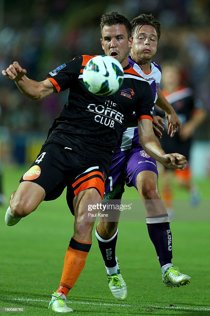 Matt Jurman (L) of the Roar and Chris Harold of the Glory contest for the ball during the round 18 A-League match between the Perth Glory and the Brisbane Roar at nib Stadium on January 26, 2013 in Perth, Australia.