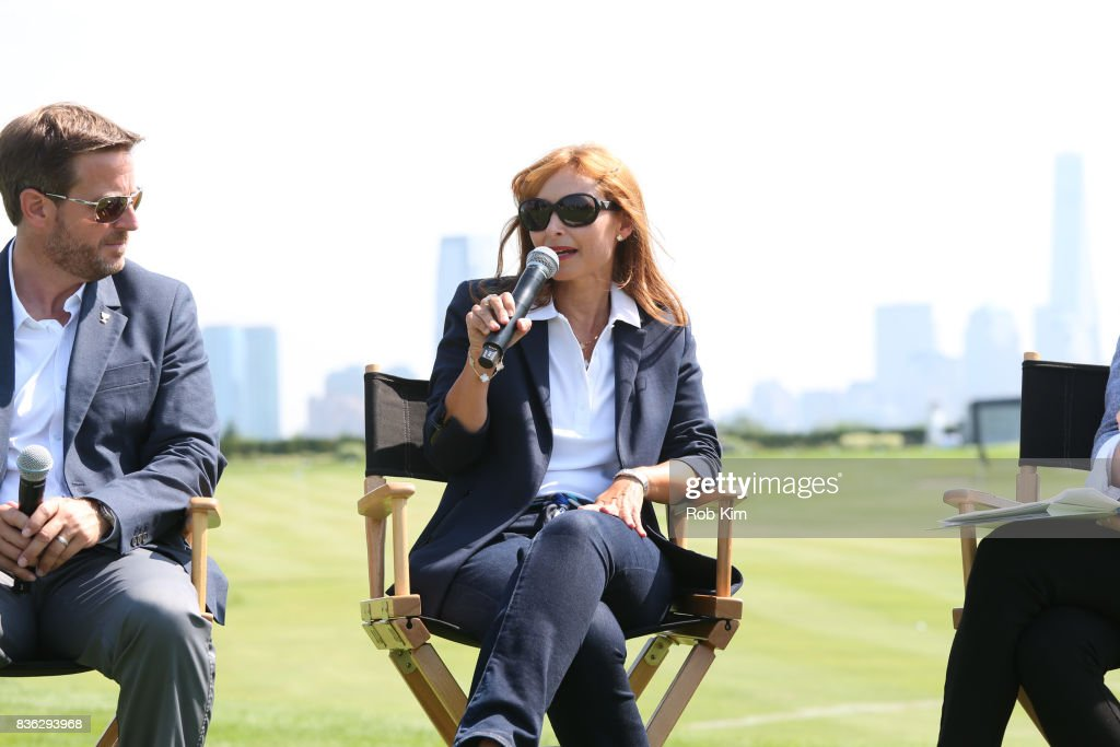 Matt Kamienski, Presidents Cup tournament director (L), and Joelle Grunberg, LACOSTE CEO attend LACOSTE 'Official Apparel Provider' unveiling during 2017 Presidents Cup Media Day at Liberty National Golf Club on August 21, 2017 in Jersey City, New Jersey.