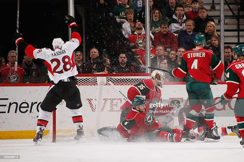 Matt Kassian celebrates after his Ottawa Senators teammate Erik Condra scores a goal with Marco Scandella Darcy Kuemper Clayton Stoner and Mikael...