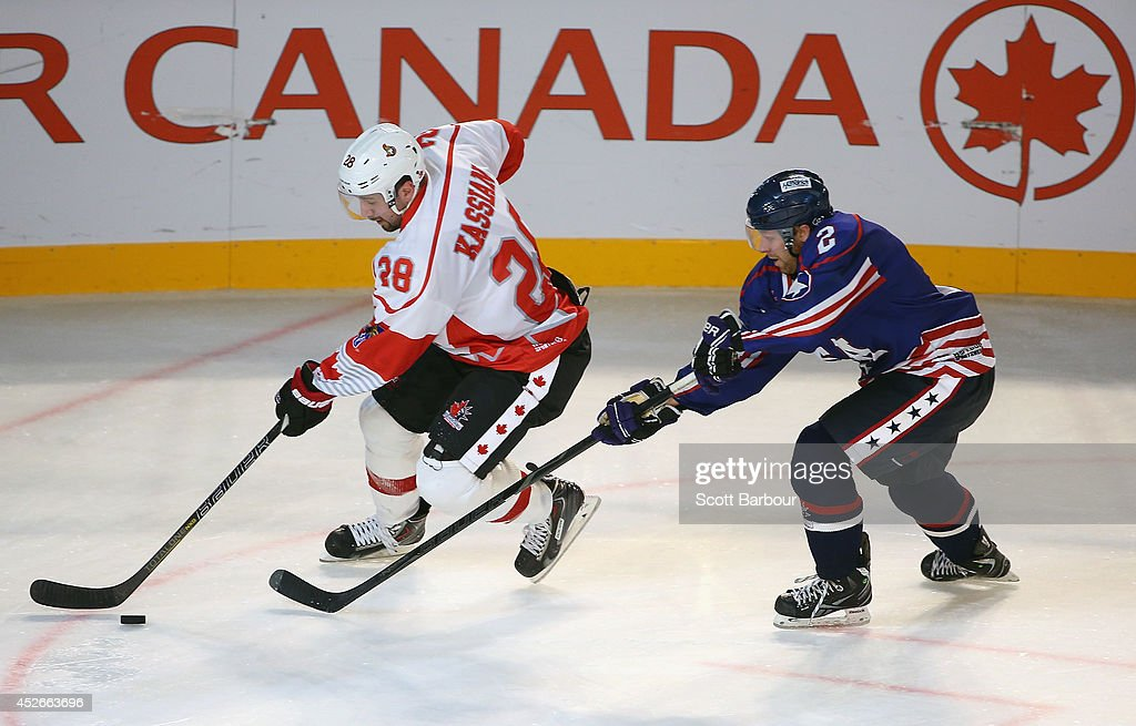 Matt Kassian of Canada and Kevin Ryan of the USA compete for the puck during the International Ice Hockey Series match between the United States and...