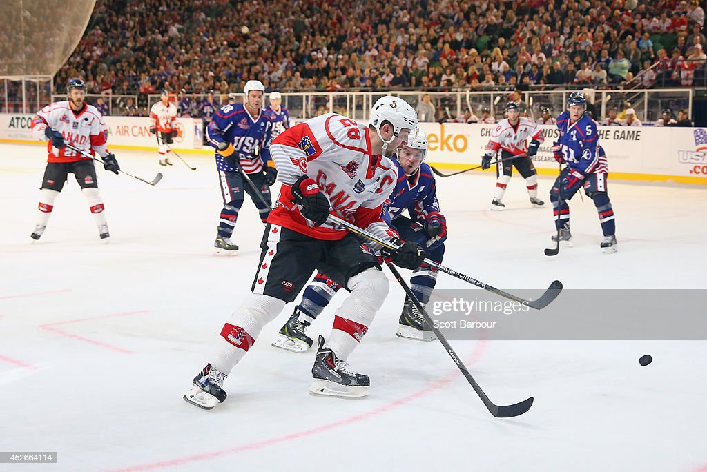 Matt Kassian of Canada competes for the puck during the International Ice Hockey Series match between the United States and Canada at Rod Laver Arena...