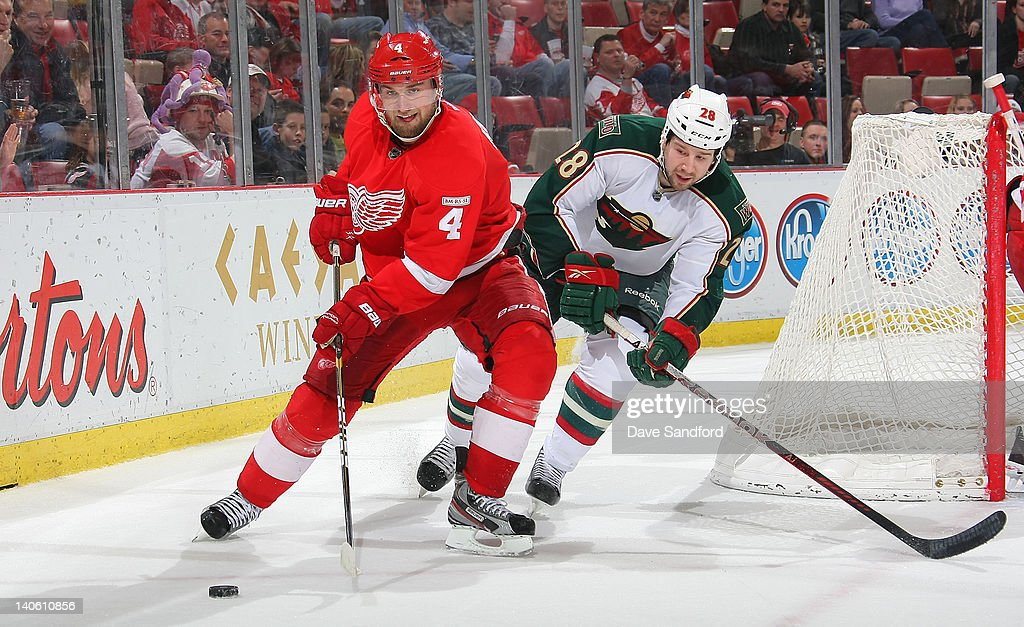 Matt Kassian #28 of the Minnesota Wild defends against <a gi-track='captionPersonalityLinkClicked' href=/galleries/search?phrase=Jakub+Kindl&family=editorial&specificpeople=716743 ng-click='$event.stopPropagation()'>Jakub Kindl</a> #4 of the Detroit Red Wings during their NHL game at Joe Louis Arena on March 2, 2012 in Detroit, Michigan.