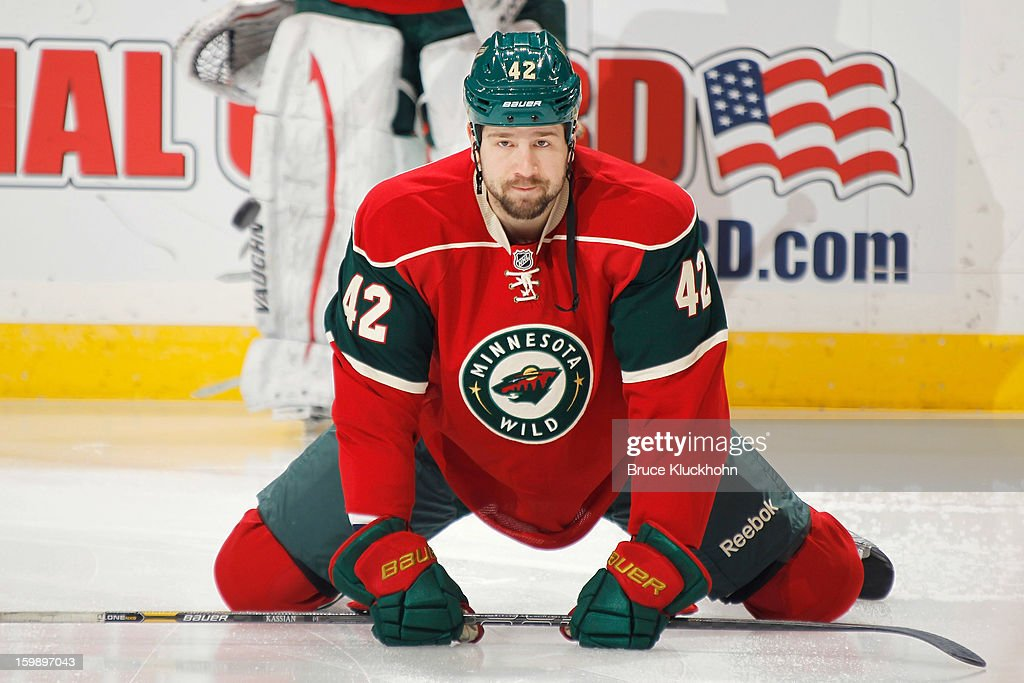 Matt Kassian #42 of the Minnesota Wild stretches prior to the game against the Nashville Predators on January 22, 2013 at the Xcel Energy Center in Saint Paul, Minnesota.