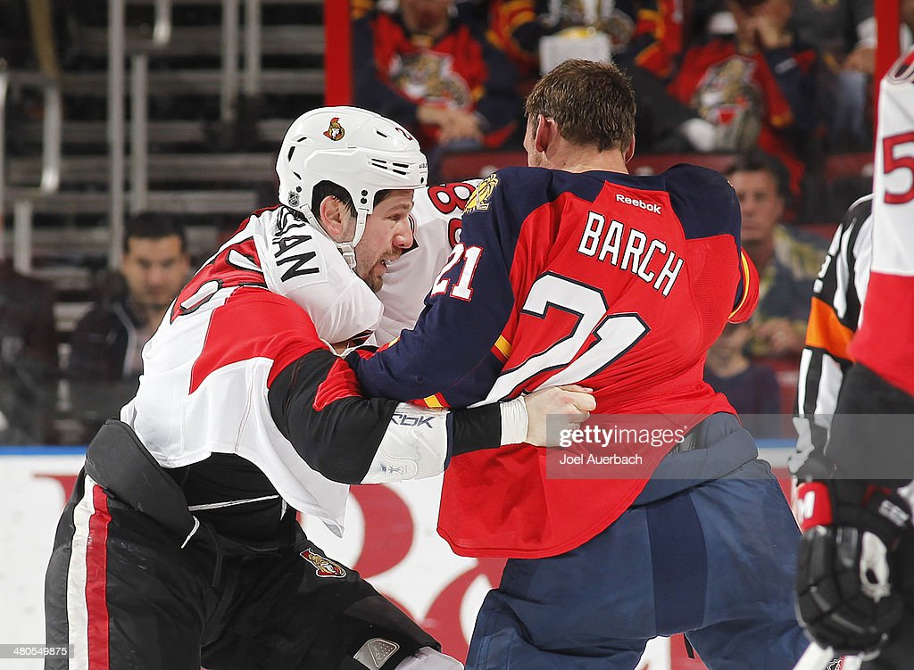 Matt Kassian of the Ottawa Senators and Krys Barch of the Florida Panthers fight during first period action at the BBT Center on March 25 2014 in...
