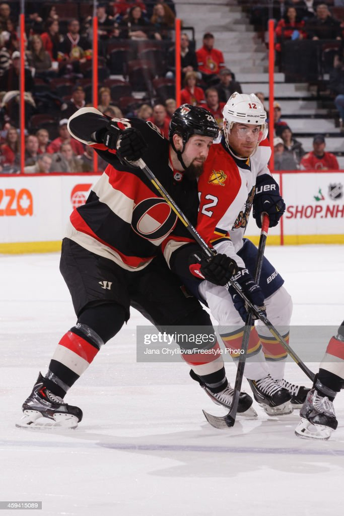 Matt Kassian of the Ottawa Senators battles for position against Jimmy Hayes of the Florida Panthers during an NHL game at Canadian Tire Centre on...