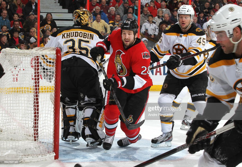 Matt Kassian #28 of the Ottawa Senators crashes the net against <a gi-track='captionPersonalityLinkClicked' href=/galleries/search?phrase=Anton+Khudobin&family=editorial&specificpeople=722106 ng-click='$event.stopPropagation()'>Anton Khudobin</a> #35 and Aaron Johnson #45 of the Boston Bruins on March 21, 2013 at Scotiabank Place in Ottawa, Ontario, Canada.