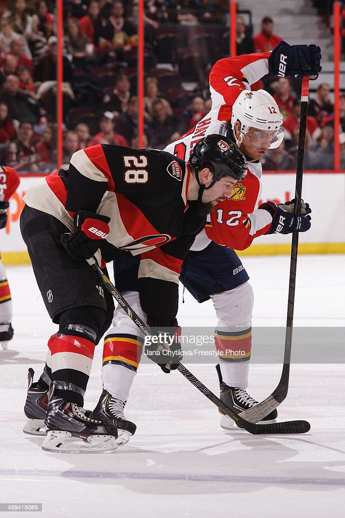 Matt Kassian of the Ottawa Senators facesoff against Jimmy Hayes of the Florida Panthers during an NHL game at Canadian Tire Centre on December 19...