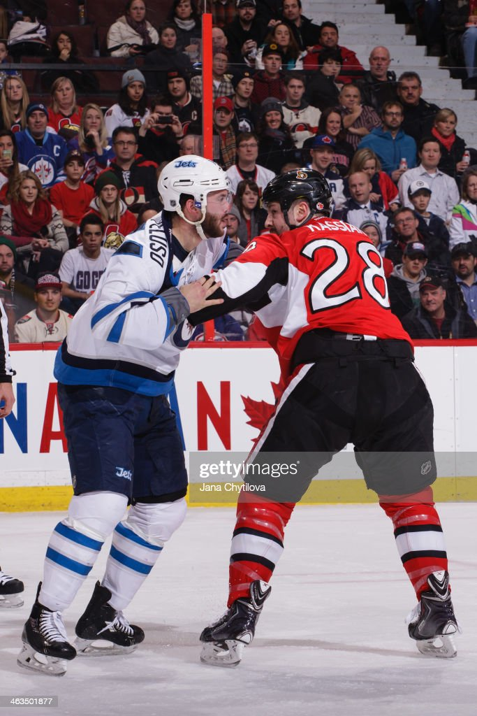 Matt Kassian of the Ottawa Senators fights Anthony Peluso of the Winnipeg Jets during an NHL game at Canadian Tire Centre on January 2 2014 in Ottawa...