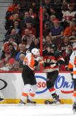 Matt Kassian of the Ottawa Senators fights with Jay Rosehill of the Philadelphia Flyers at Canadian Tire Centre on December 9 2013 in Ottawa Ontario...