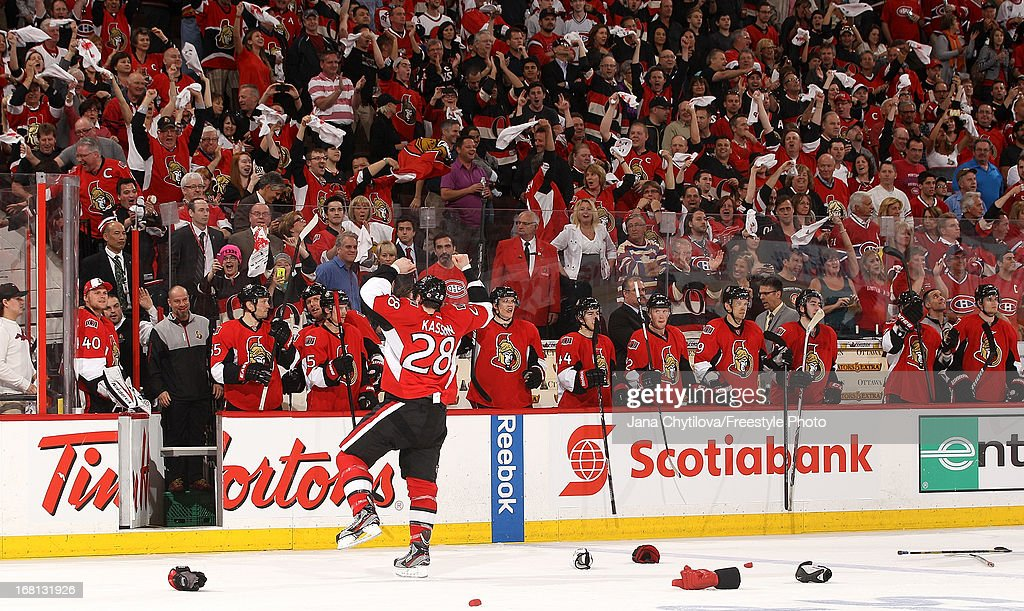 <a gi-track='captionPersonalityLinkClicked' href=/galleries/search?phrase=Matt+Kassian&family=editorial&specificpeople=2222189 ng-click='$event.stopPropagation()'>Matt Kassian</a> #28 of the Ottawa Senators gestures to crowd as he exits the ice after being assessed a fighting penalty and a game misconduct against the Montreal Canadiens in Game Three of the Eastern Conference Quarterfinals during the 2013 NHL Stanley Cup Playoffs at Scotiabank Place, on May 5, 2013 in Ottawa, Ontario, Canada.