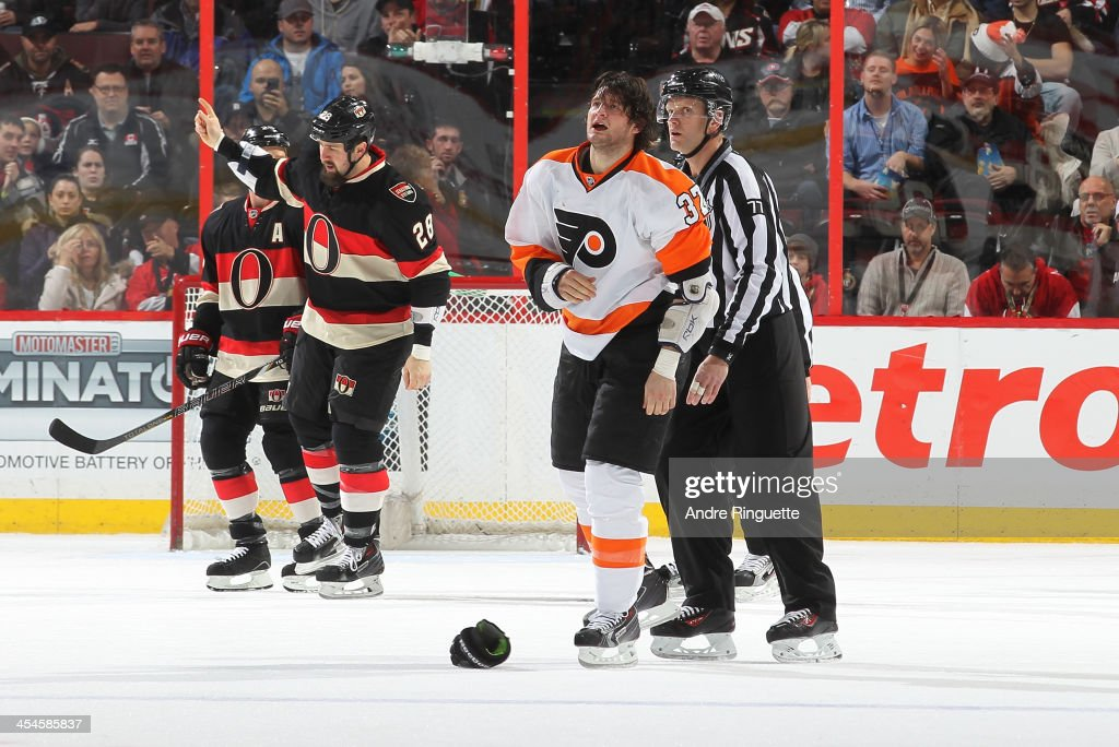 Matt Kassian of the Ottawa Senators gestures to pump up the fans after a fight with Jay Rosehill of the Philadelphia Flyers at Canadian Tire Centre...