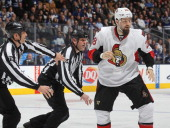 Matt Kassian of the Ottawa Senators gets set to due battle against the Toronto Maple Leafs during an NHL game at the Air Canada Centre on February 1...