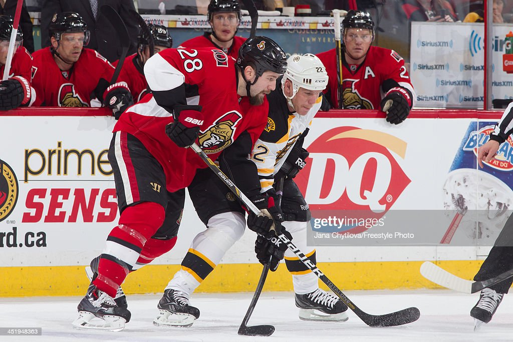 Matt Kassian of the Ottawa Senators prepares for a faceoff against Shawn Thornton of the Boston Bruins during an NHL game at Canadian Tire Centre on...