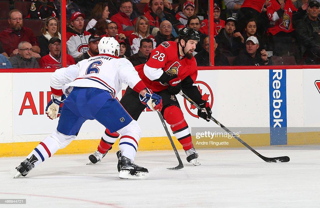 Matt Kassian of the Ottawa Senators skates against Douglas Murray of the Montreal Canadiens at Canadian Tire Centre on January 16 2014 in Ottawa...