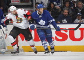 Matt Kassian of the Ottawa Senators skates against Tim Gleason of the Toronto Maple Leafs during an NHL game at the Air Canada Centre on February 1...