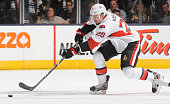 Matt Kassian of the Ottawa Senators skates with the puck during home opener NHL game action against the Toronto Maple Leafs October 5 2013 at Air...
