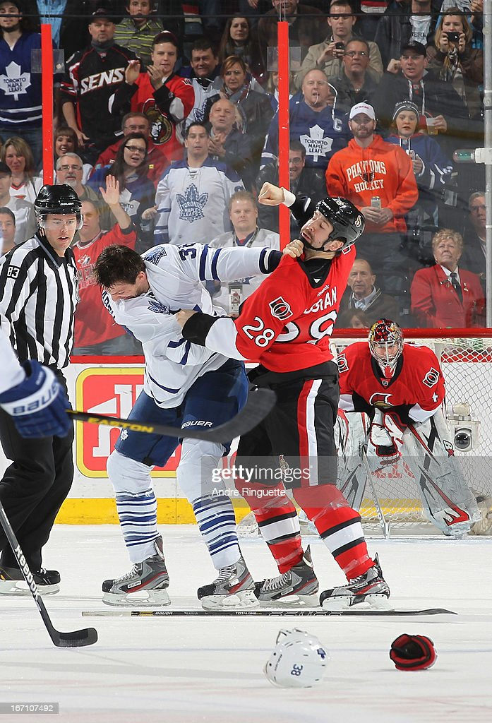 <a gi-track='captionPersonalityLinkClicked' href=/galleries/search?phrase=Matt+Kassian&family=editorial&specificpeople=2222189 ng-click='$event.stopPropagation()'>Matt Kassian</a> #28 of the Ottawa Senators throws a punch in a first period fight with <a gi-track='captionPersonalityLinkClicked' href=/galleries/search?phrase=Frazer+McLaren&family=editorial&specificpeople=4601054 ng-click='$event.stopPropagation()'>Frazer McLaren</a> #38 of the Toronto Maple Leafs on April 20, 2013 at Scotiabank Place in Ottawa, Ontario, Canada.